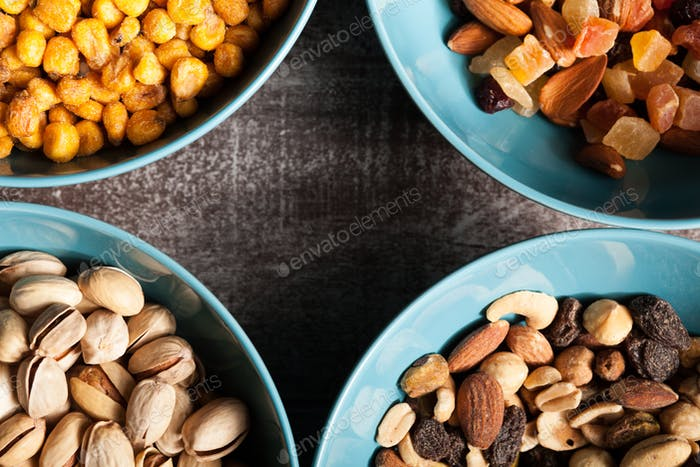 Mix of different type of nuts in blue bowls