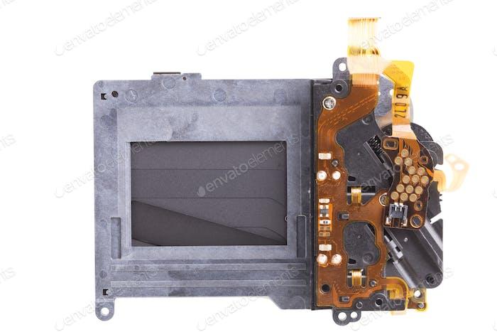 Verschlussmechanismus einer Fotokamera. Nahaufnahme. Isoliert auf weißem Hintergrund.