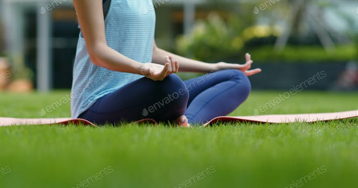 Woman do yoga at the park