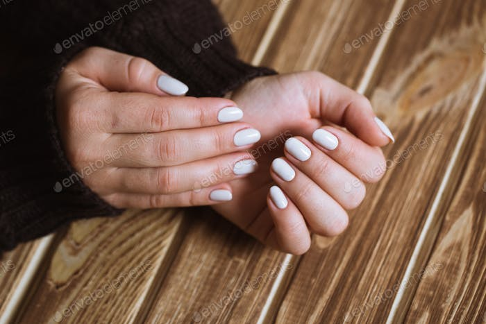 Beautiful woman nails with a beautiful bright manicure