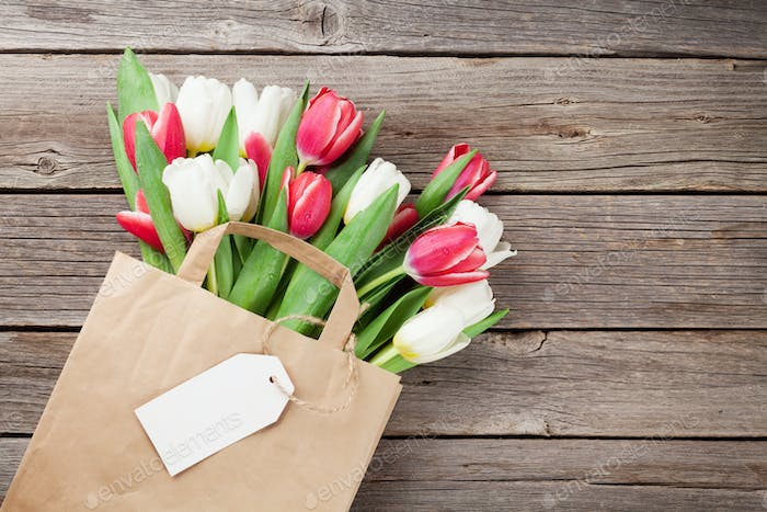 Colorful tulips in paper bag