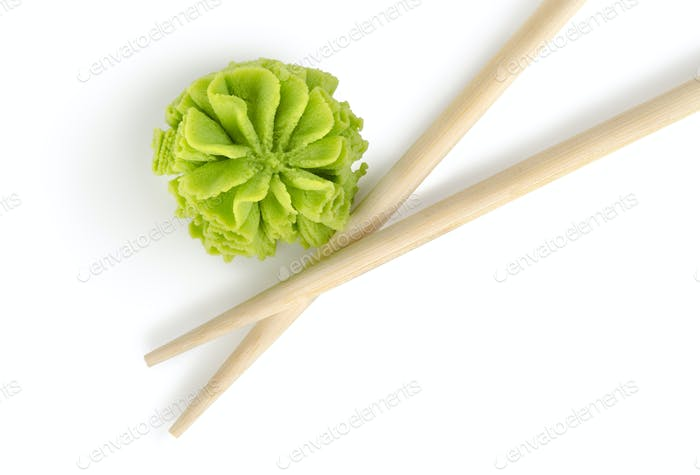 Wooden chopsticks and wasabi isolated