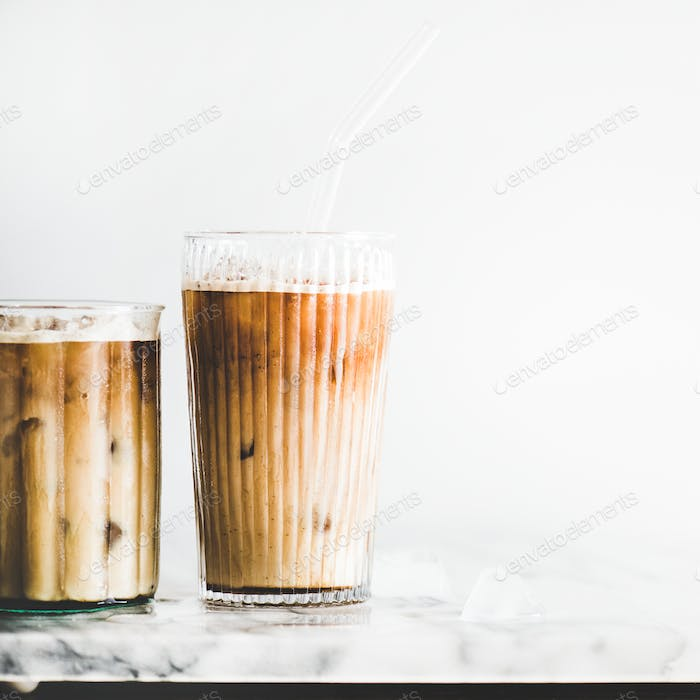 Iced latte coffee in glasses with straws, square crop