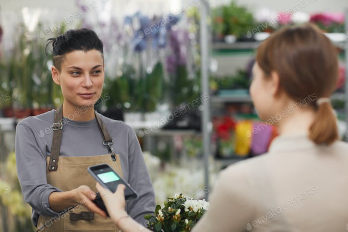 Customer Paying by NFS in Flower Shop