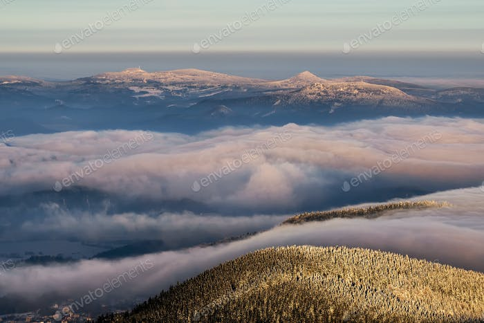 Amazing view from Jested mountain peak . Typical snowy morning, Czech republic.
