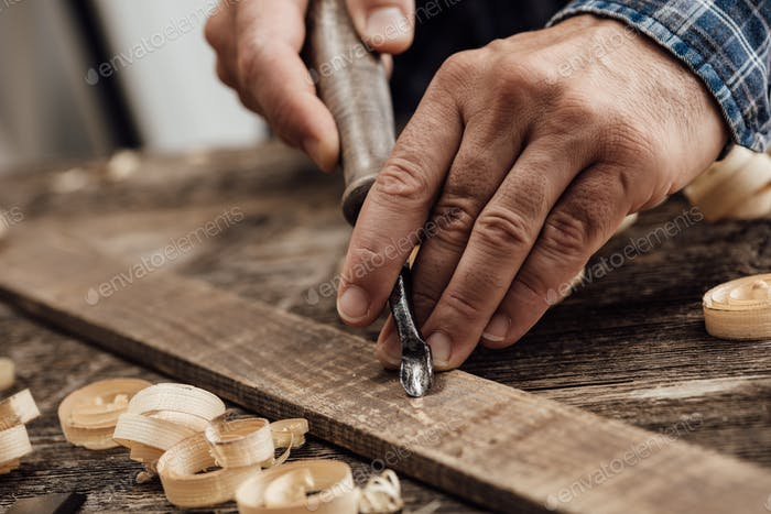 Carpenter carving wood