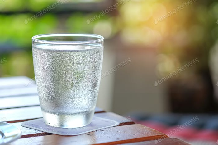 Water glass on wooden table.