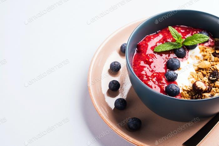 Yogurt smoothie bowl with blended raspberries