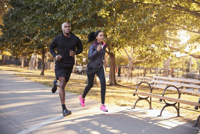 Young black couple jogging in a Brooklyn park