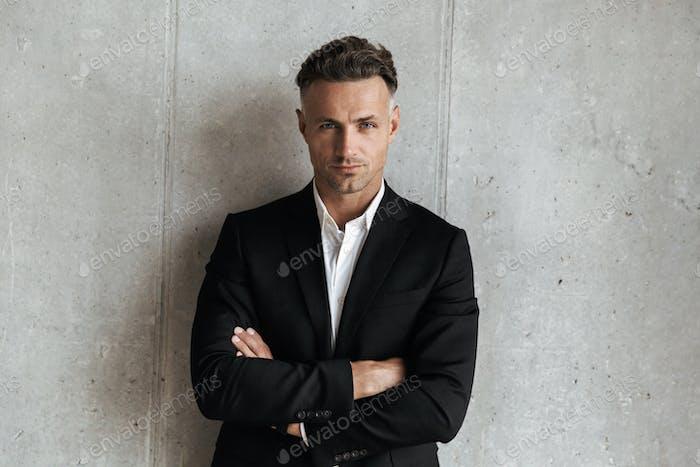 Confident man dressed in suit