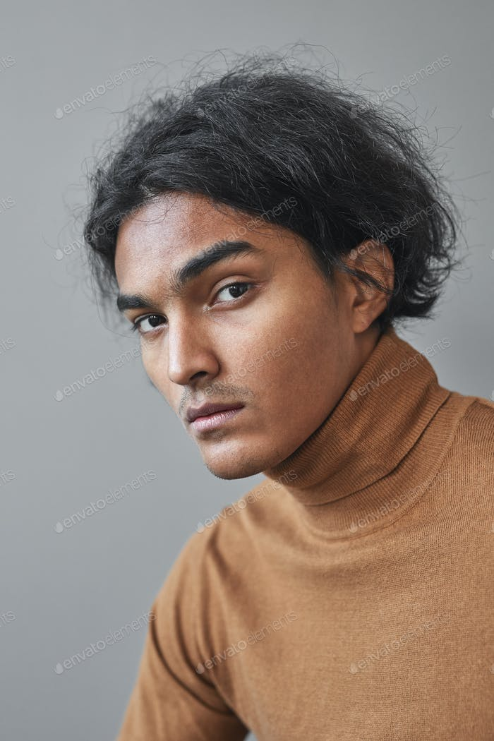 Mixed-Race Young Man on Grey