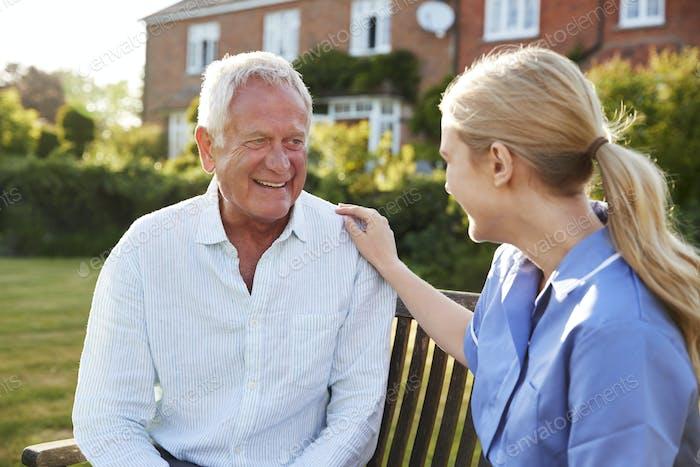 Nurse Talking To Senior Man In Residential Care Home