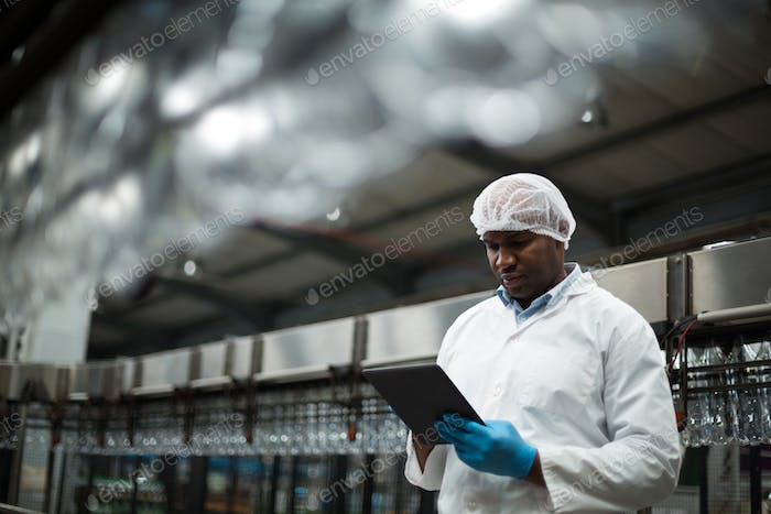 Factory engineer using digital tablet in the factory