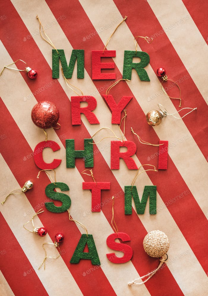 Christmas holiday greeting banner concept over vintage striped paper