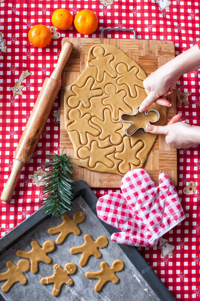 Hands making from dough Christmas gingerbread man