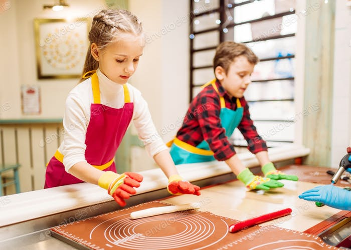 Little girl and boy learn to make caramel