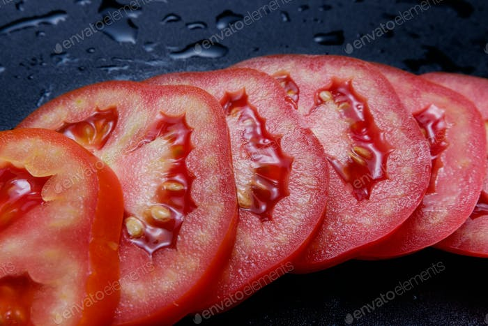 Juicy sliced red tomato