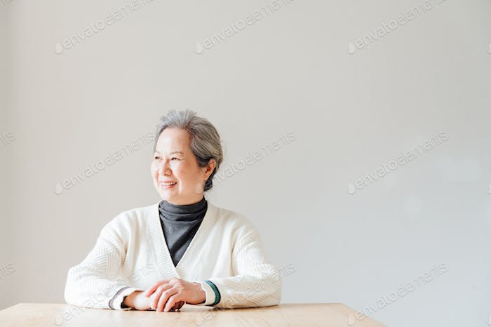Portrait of senior woman sitting at the table