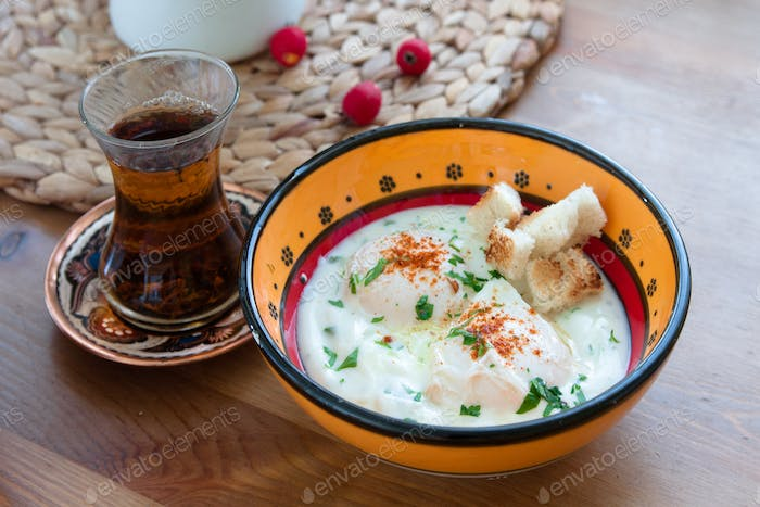 Cilbir, poached egg in yogurt with spiced butter and herbs, turkish cuisine