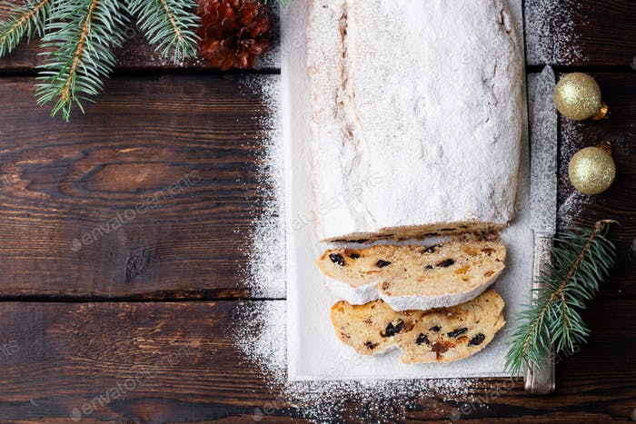 Christmas Stollen Cake with Icing Sugar. Traditional Dresdner Pastry. Top View. Copy Space.