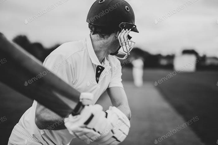 Jugador de cricket en el campo en Acción