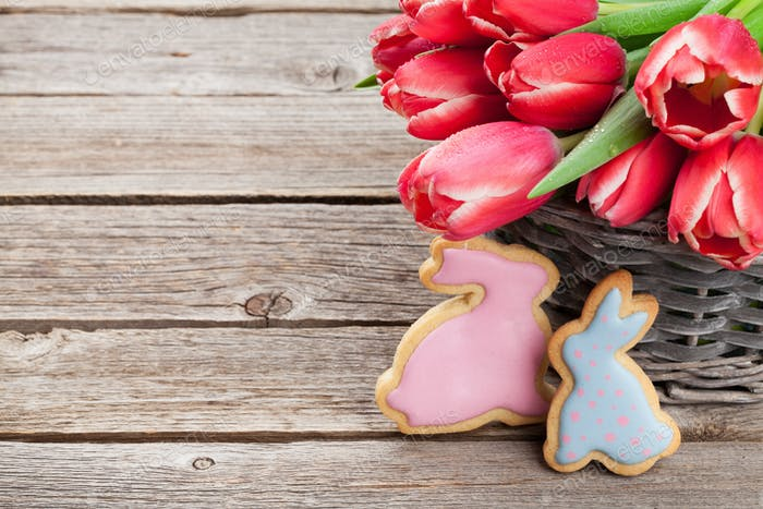Red tulip flowers and Easter cookies