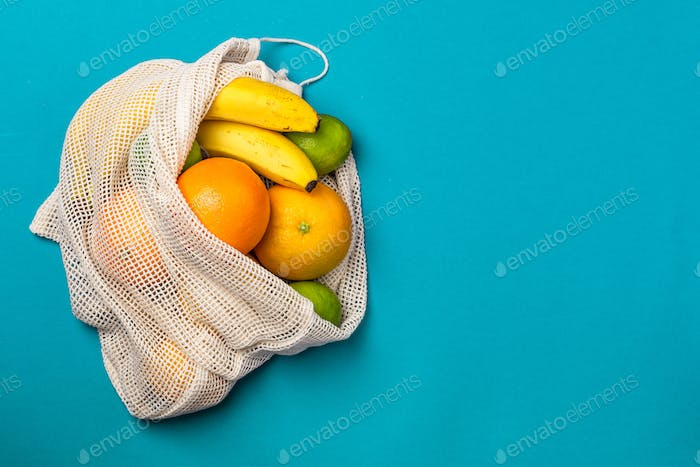 Reusable Eco Friendly Shopping Bag with Fruits. Ecology and Recycling Trend in Fashion Concept