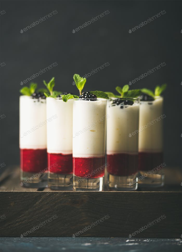 Dessert in glass with blackberries and mint, copy space
