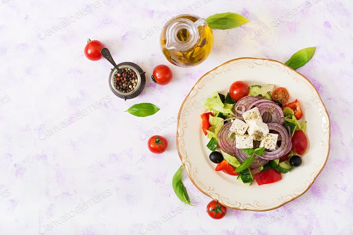 Greek salad with fresh tomato, cucumber, red onion, basil, lettuce, feta cheese, black olives a