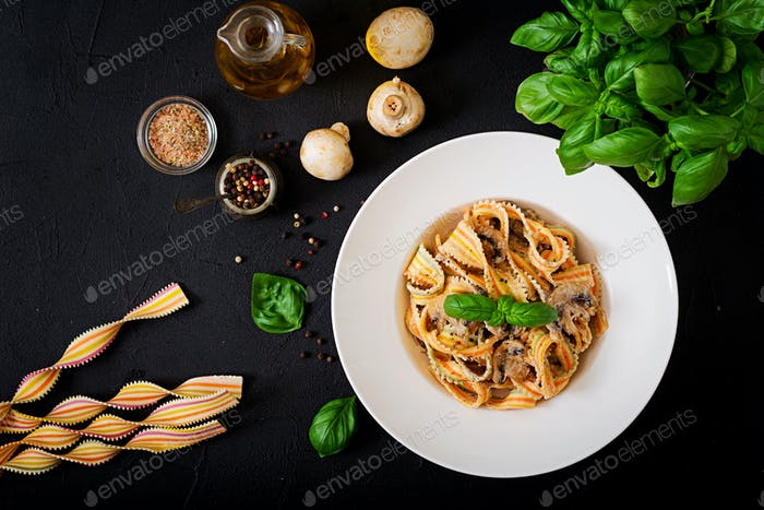 Colorful Pasta pappardelle with mushrooms in cream sauce. Flat lay. Top view