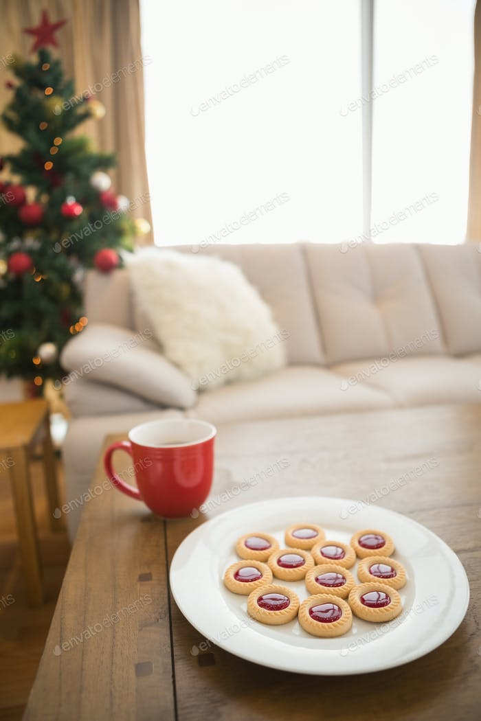 Cookies and mug on coffee table at christmas at home in the living room