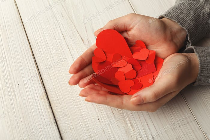 Valentine day background, hearts in female hands