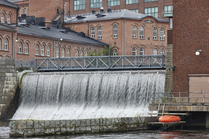 Traditional industrial buildings and dam in Tampere city center. Finland