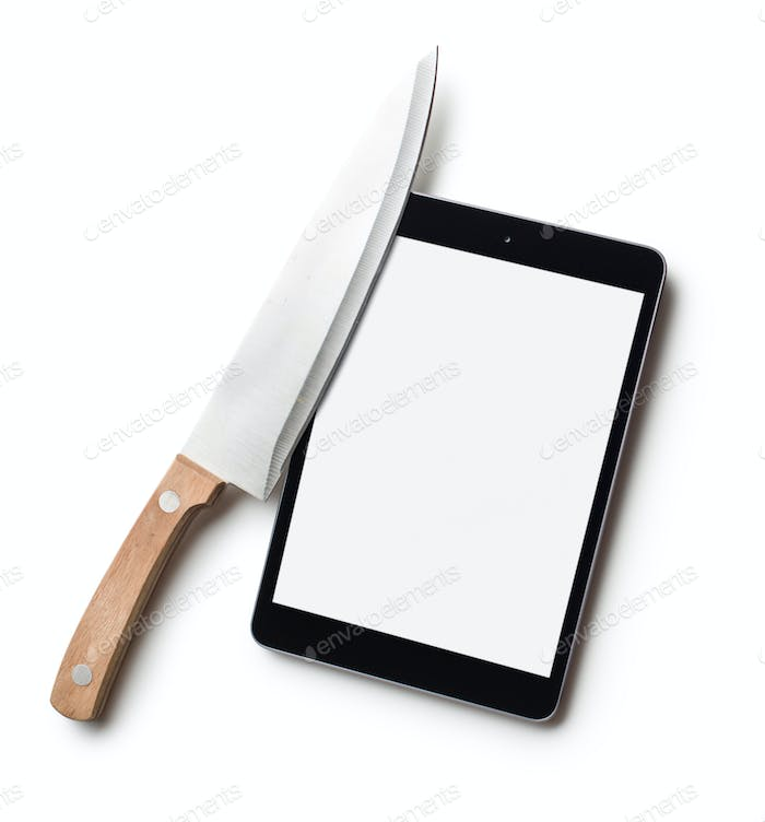 computer tablet and knife