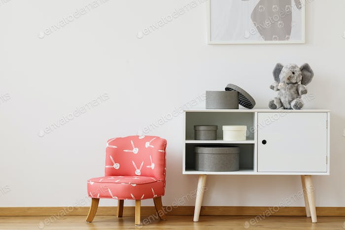 Red chair with rabbits pattern