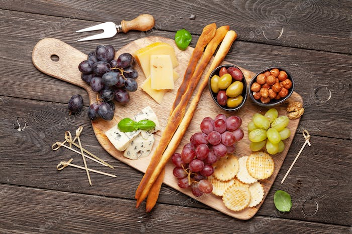 Cheese, meat, grapes and olives antipasto