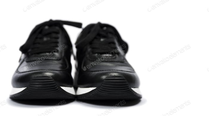 Black sneakers isolated on white