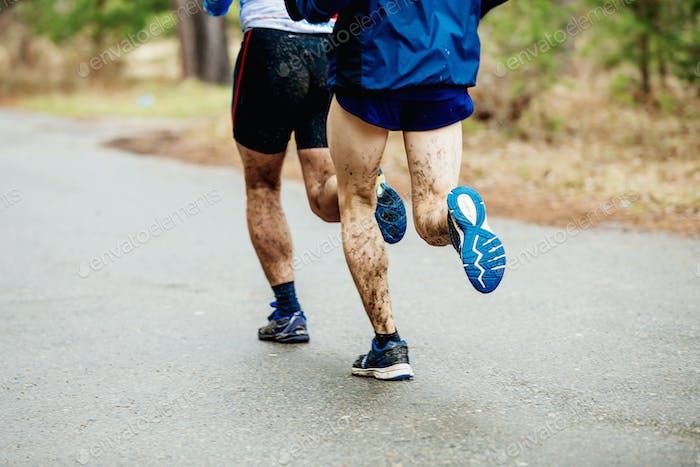two runners with dirty feet