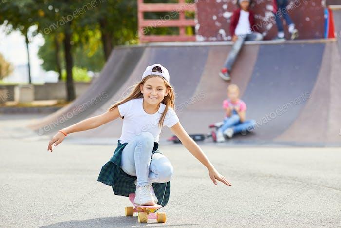 Girl on skateboard in the park