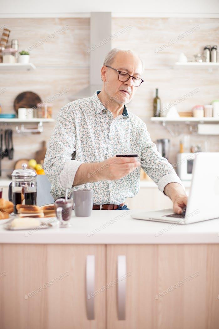 Elderly man checking finances