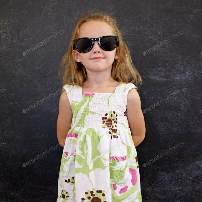 Beautiful little girl wearing sunglasses