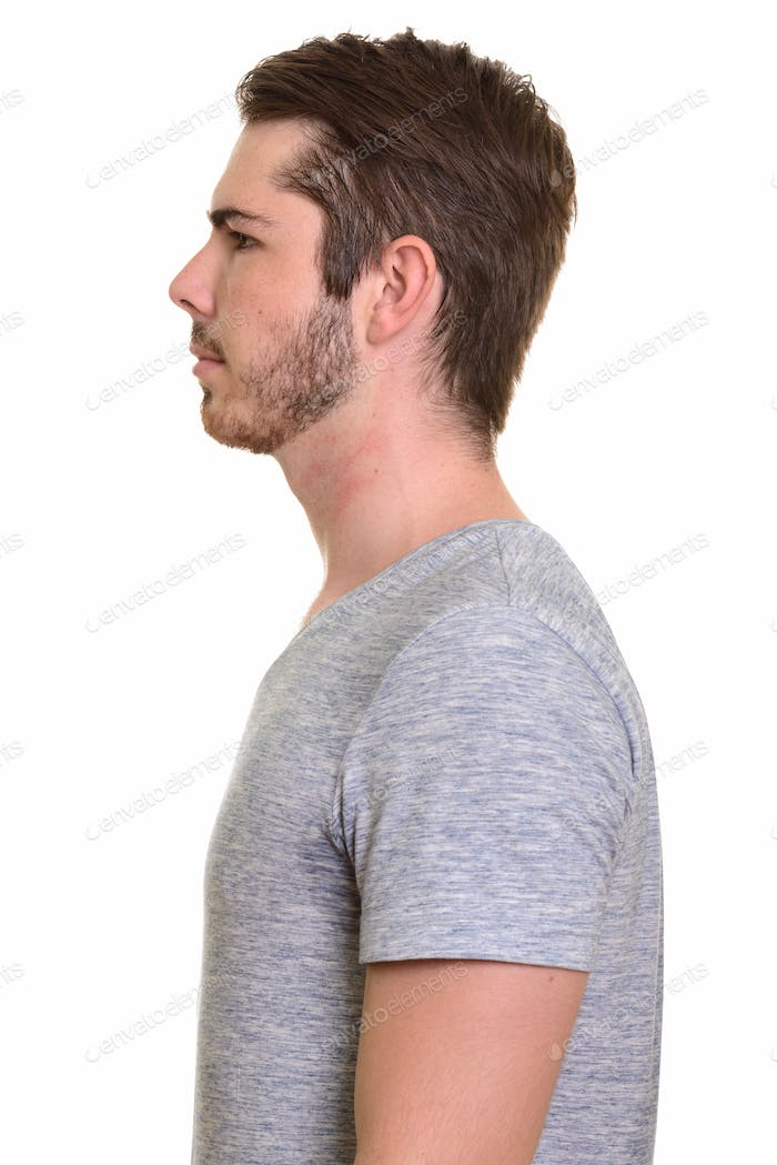 Closeup profile view of young handsome bearded man