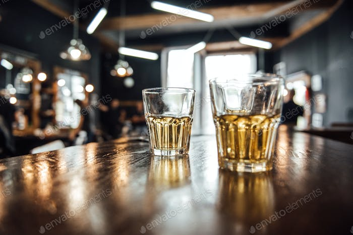 glasses of whiskey on the table