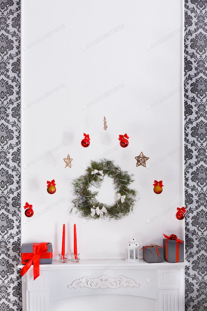 Beautiful christmas decorated fireplace in modern interior, holiday concept