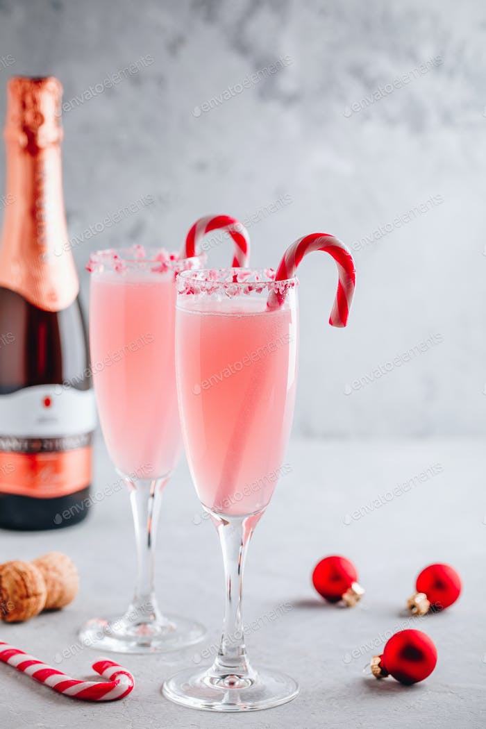 Festive Christmas drink Peppermint Bark Mimosa cocktail with champagne or prosecco and candy cane