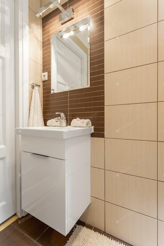 Corner of a tiled bathroom