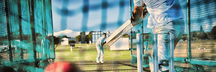 Low section of sportsman playing cricket at field
