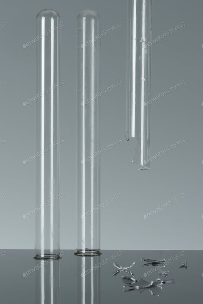 3 test tubes, one broken