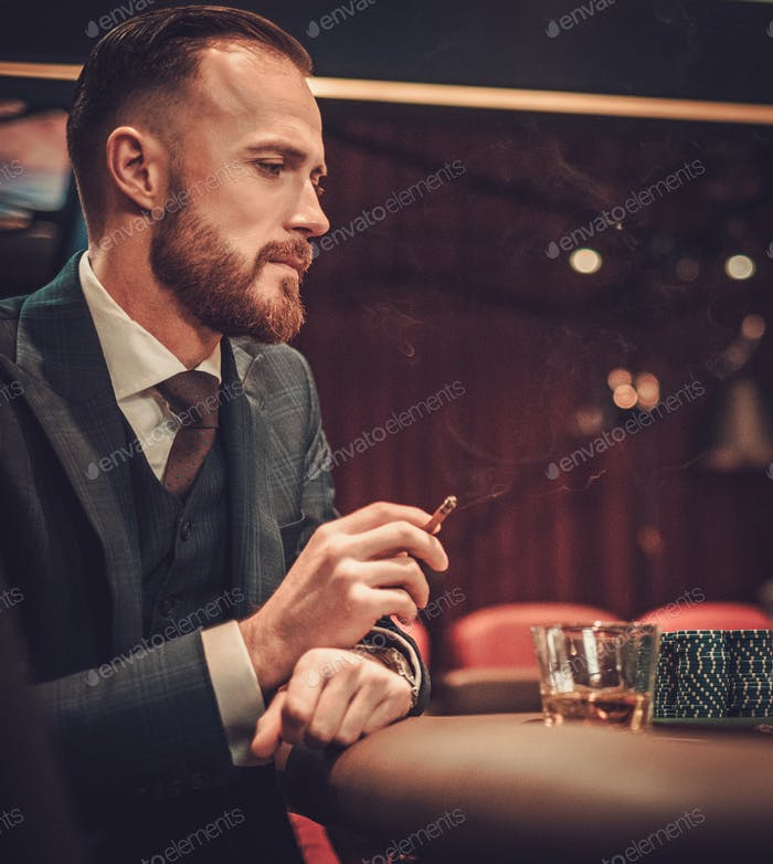 Upper class man gambling in a casino