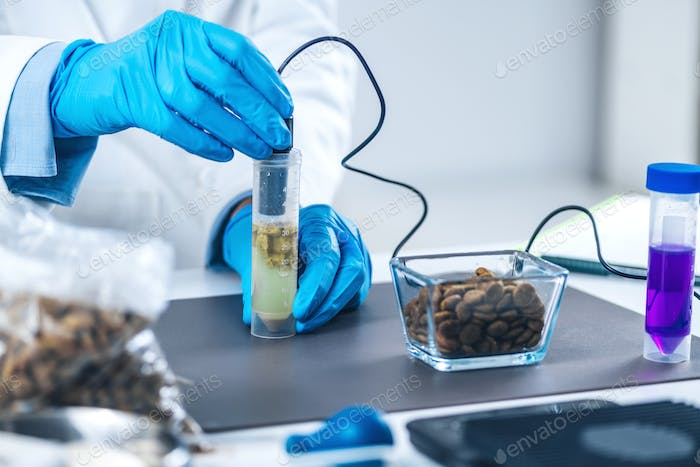 Scientist Measuring PH of Dissolved Pet Food in Sample Tube with PH Meter